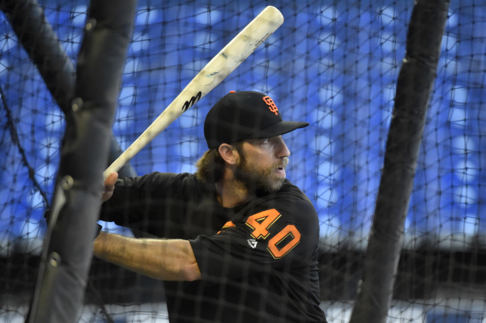 If the universal DH is adopted, we'd lose out on Madison Bumgarner hitting. (Photo by Eric Espada/Getty Images)