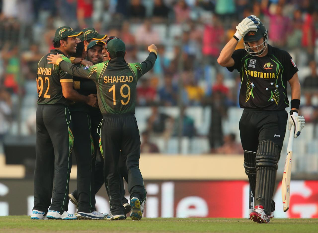 DHAKA, BANGLADESH - MARCH 23:  Zulfiqar Babar of Pakistan celebrates with his teammates after dismissing Shane Watson of Australia during the ICC World Twenty20 Bangladesh 2014 match between Australia and Pakistan at Sher-e-Bangla Mirpur Stadium on March 23, 2014 in Dhaka, Bangladesh.  (Photo by Scott Barbour/Getty Images)
