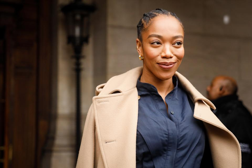 PARIS, FRANCE - MARCH 02: Naomi Ackie wearing Stella McCartney trench coat, navy shirt green stilettos and baby blue leather bag  outside Stella McCartney during Paris Fashion Week Womenswear Fall/Winter 2020/2021 Day Eight on March 02, 2020 in Paris, France. (Photo by Hanna Lassen/Getty Images)