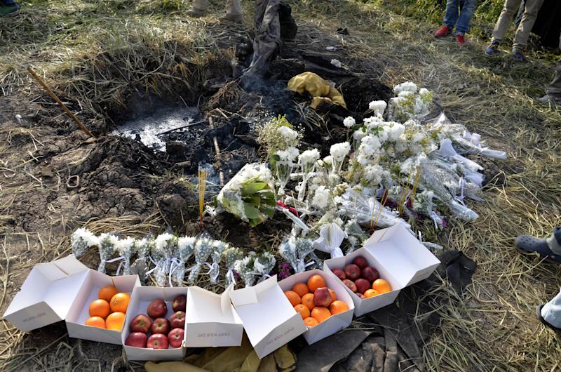 Fruit, flowers and incense laid by relatives of tourists from Hong Kong killed in a hot air balloon accident at the site during a memorial ceremony for the victims in Luxor, Egypt, Saturday, March 2, 2013. Nineteen people were killed on Tuesday, Feb. 26, 2013 in what appeared to be the deadliest hot air ballooning accident on record. The balloon was carrying 20 tourists from France, Britain, Belgium, Japan, Hong Kong, and an Egyptian pilot.(AP Photo/Ibrahim Zayed)