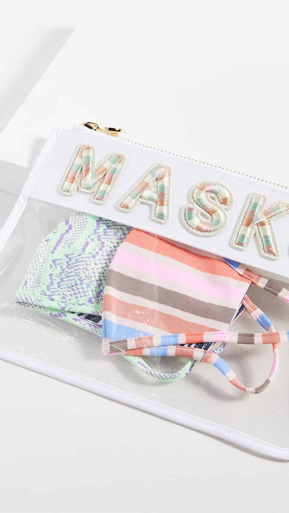 <p>Gift them something they'll use every day, this <span>Stoney Clover Lane Clear Flat Masks Pouch</span> ($143).</p>