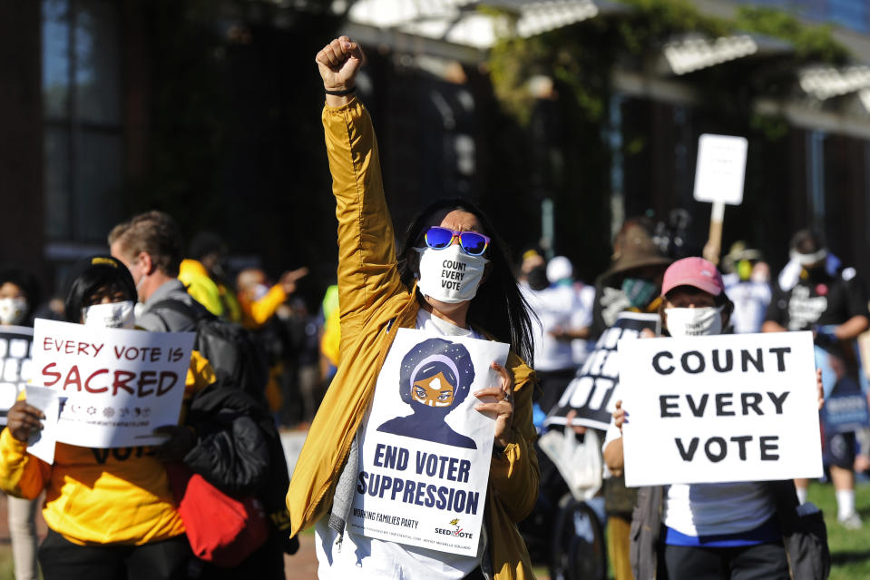 People listen and react to speakers during a count every vote protest at Independence Mall, Tuesday, Nov. 4, 2020, in Philadelphia. (AP Photo/Michael Perez)