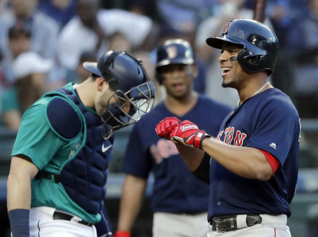 Boston Red Sox's Xander Bogaerts, right, smiles as he crosses the plate after hitting a three-run home run during the third inning of a baseball game against the Seattle Mariners on Friday, June 15, 2018, in Seattle. (AP Photo/Ted S. Warren)