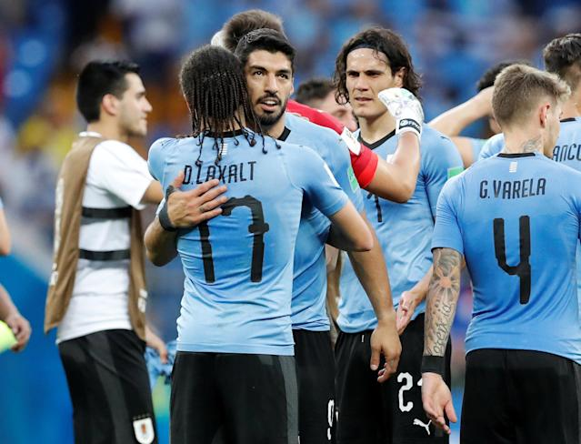 Soccer Football - World Cup - Group A - Uruguay vs Saudi Arabia - Rostov Arena, Rostov-on-Don, Russia - June 20, 2018 Uruguay's Luis Suarez celebrates victory with Diego Laxalt after the match REUTERS/Carlos Garcia Rawlins