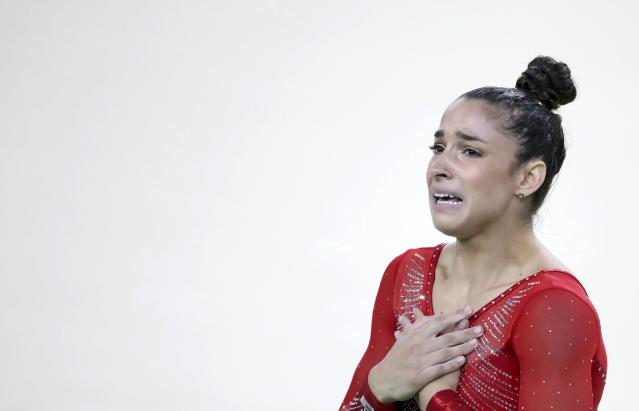 2016 Rio Olympics - Artistic Gymnastics - Final - Women's Individual All-Around Final - Rio Olympic Arena - Rio de Janeiro, Brazil - 11/08/2016. Alexandra Raisman (USA) of the U.S. reacts after winning the silver medal. REUTERS/Damir Sagolj FOR EDITORIAL USE ONLY. NOT FOR SALE FOR MARKETING OR ADVERTISING CAMPAIGNS.