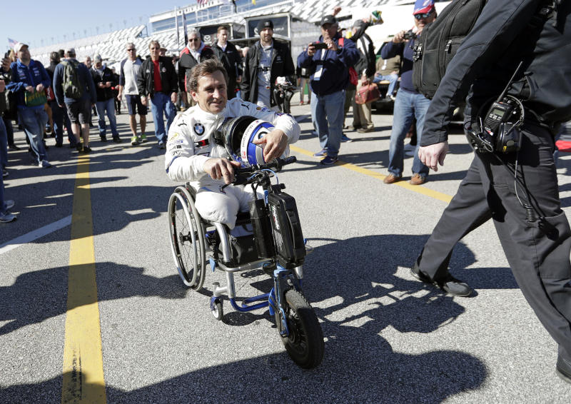 Alex Zanardi makes his way back to his garage after driving during a practice session for the IMSA 24 hour race at Daytona International Speedway, Friday, Jan. 25, 2019, in Daytona Beach, Fla. (AP Photo/John Raoux)