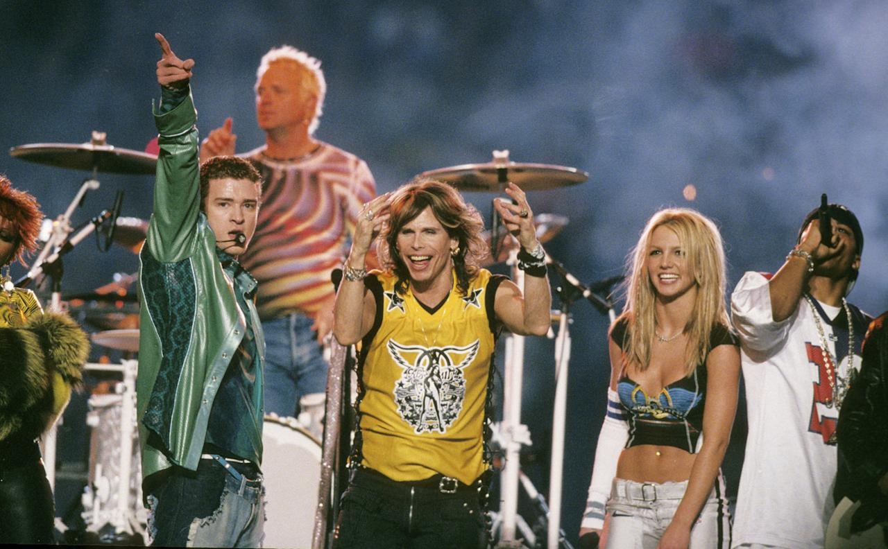 Justin Timberlake, Joey Kramer and Steven Tyler of Aerosmith, Britney Spears, and Nelly perform at the halftime show of Super Bowl XXXV between the Baltimore Ravens and New York Giants at Raymond James Stadium in Tampa, Florida, on January 28, 2001.  (Photo by Al Messerschmidt/Getty Images)