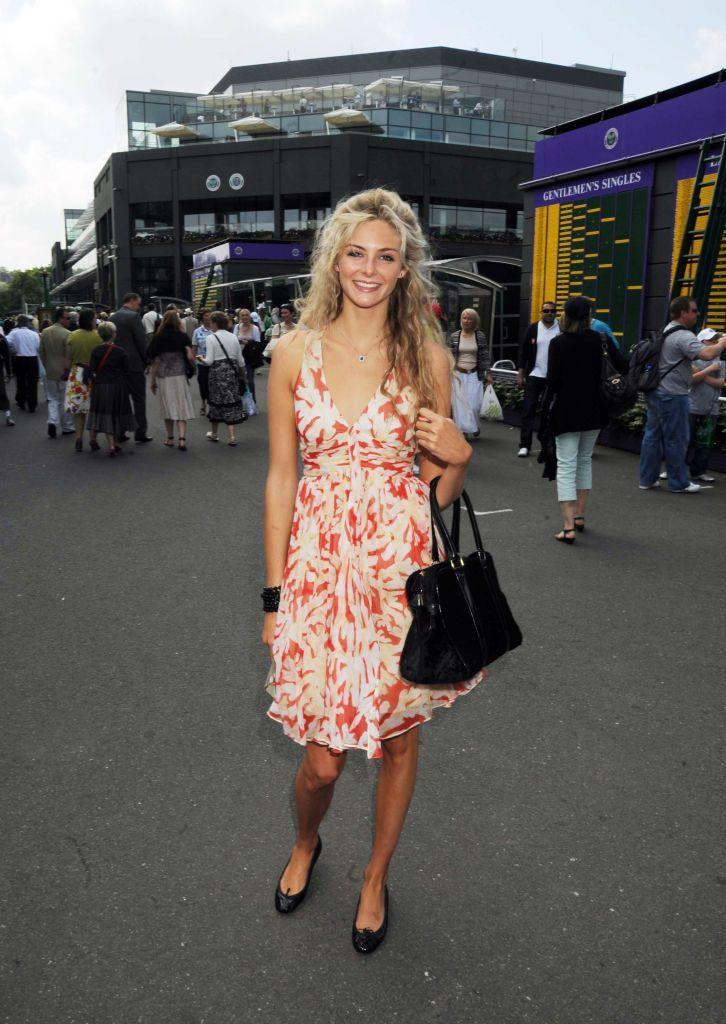 <p>Eggerton paired a floral dress with black ballet pumps and matching bag. </p>