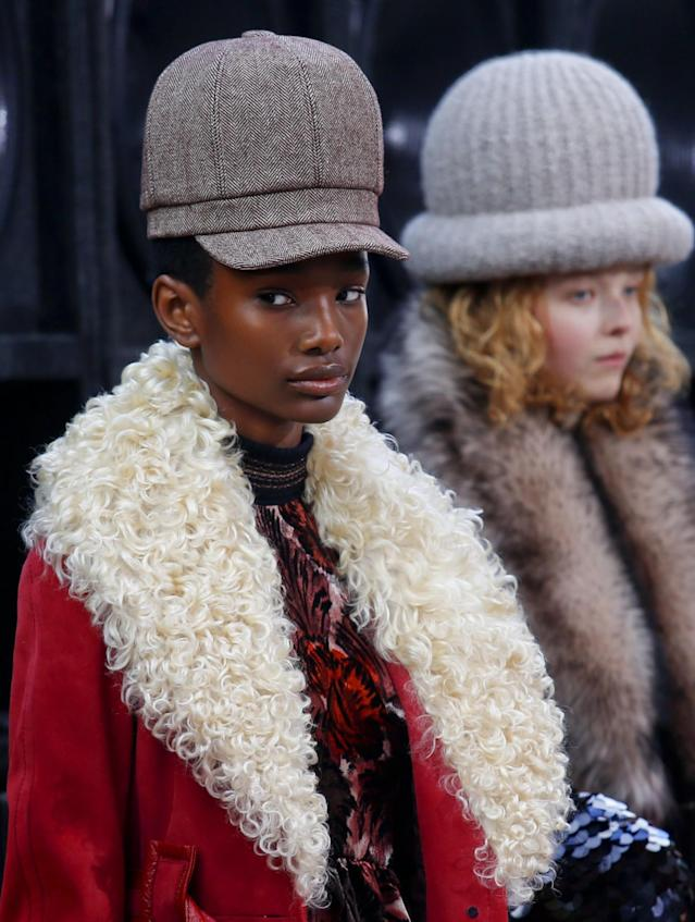 <p>Focusing on headwear rather than hair, the Fall 2017 collection featured oversized beanies and newsboy caps. (Photo: AP Images) </p>