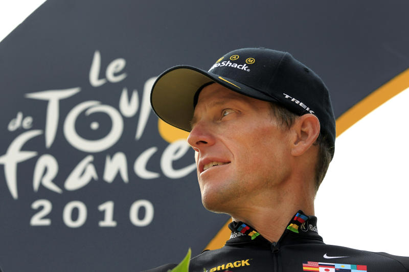 FILE - In this July 25, 2010, file photo, cyclist Lance Armstrong stands on the podium after the 20th and last stage of the Tour de France cycling race in Paris, France. Even after whistleblowers unveiled their scathing report portraying Armstrong as an unrepentant drug cheat, the argument over what to make of his life story rages on. (AP Photo/Bas Czerwinski, File)