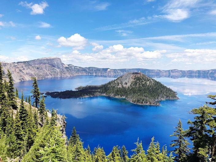 "<p>Sitting atop the Cascade Mountain Range is <a href=""https://www.nps.gov/crla/index.htm"" rel=""nofollow noopener"" target=""_blank"" data-ylk=""slk:Crater Lake"" class=""link rapid-noclick-resp"">Crater Lake</a> — the deepest lake in the country at 1,943 feet deep. Surrounded by picturesque mountain peaks, it's the ideal hike for experienced hikers and cyclists. If you don't like to hike, you can still get a great view while staying in your vehicle. </p><p>Stay at the <a href=""http://prospecthotel.com/"" rel=""nofollow noopener"" target=""_blank"" data-ylk=""slk:Prospect Historic Hotel"" class=""link rapid-noclick-resp"">Prospect Historic Hotel</a>, which was built in 1890 and was visited by Theodore Roosevelt!</p>"