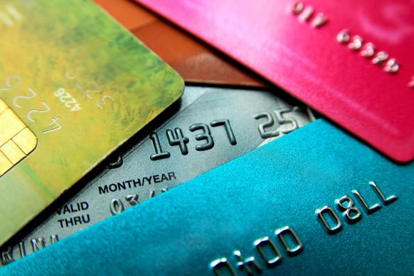 Colorful credit cards stacked loosely on top of each other.