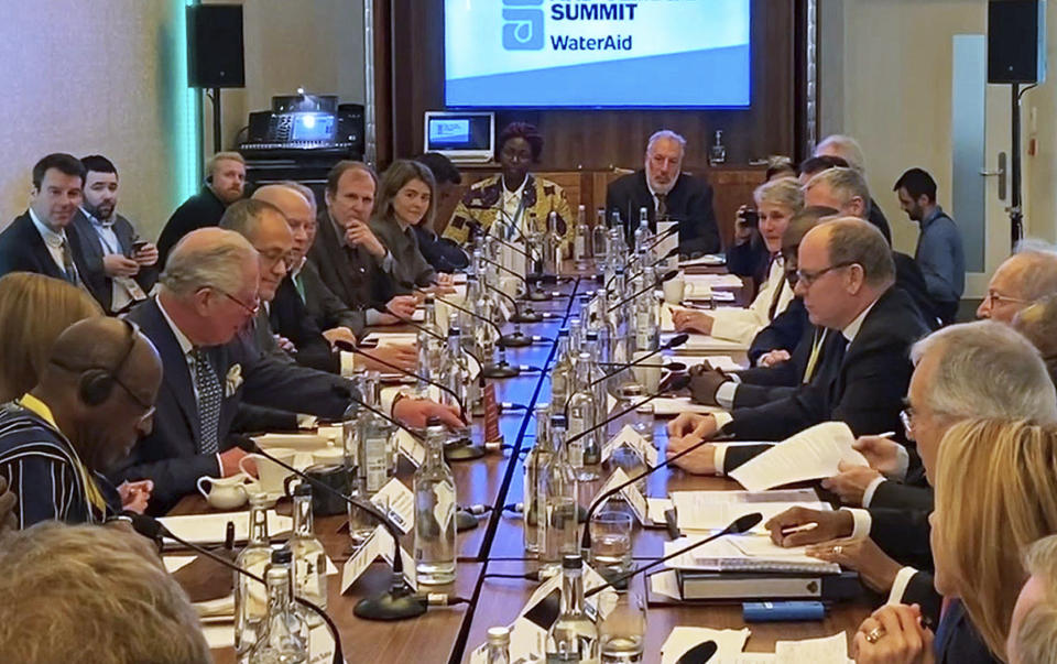 Image from video taken on March 10, 2020 of Britain's Prince Charles sat opposite Prince Albert of Monaco at the WaterAid charity's Water and Climate event in London. Clarence House office reported on Wednesday, March 25, 2020 that 71-year-old Prince Charles is showing mild symptoms of COVID-19 and is self-isolating at a royal estate in Scotland. It says his wife Camilla has tested negative. For some people the COVID-19 coronavirus causes mild or moderate symptoms, but for others it causes severe illness. (PA via AP)