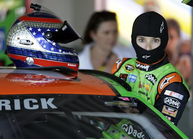 Danica Patrick prepares to climb into her car for practice for Sunday's NASCAR Daytona 500 Sprint Cup series auto race at Daytona International Speedway in Daytona Beach, Fla., Wednesday, Feb. 19, 2014. (AP Photo/John Raoux)