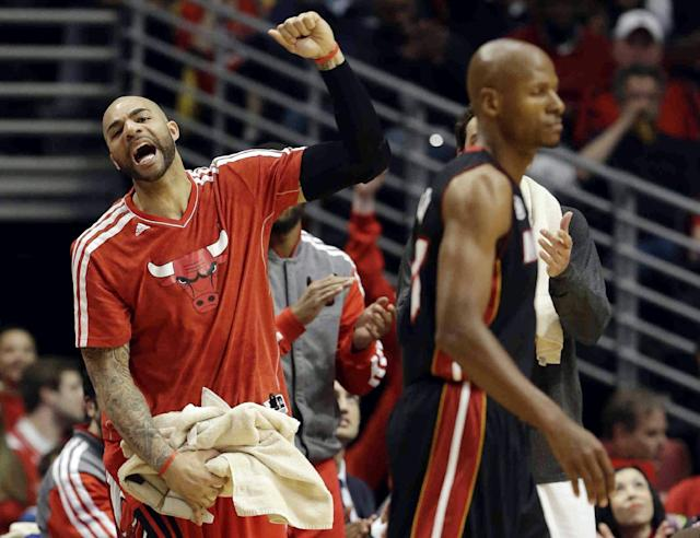 Chicago Bulls forward Carlos Boozer reacts on the bench during the first half of Game 4 of an NBA basketball playoffs Eastern Conference semifinal against the Miami Heat on Monday, May 13, 2013, in Chicago. (AP Photo/Nam Y. Huh)
