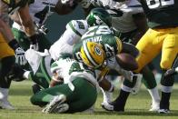Green Bay Packers' Patrick Taylor fumbles as he is hit by New York Jets' Hamsah Nasirildeen during the second half of a preseason NFL football game Saturday, Aug. 21, 2021, in Green Bay, Wis. (AP Photo/Matt Ludtke)