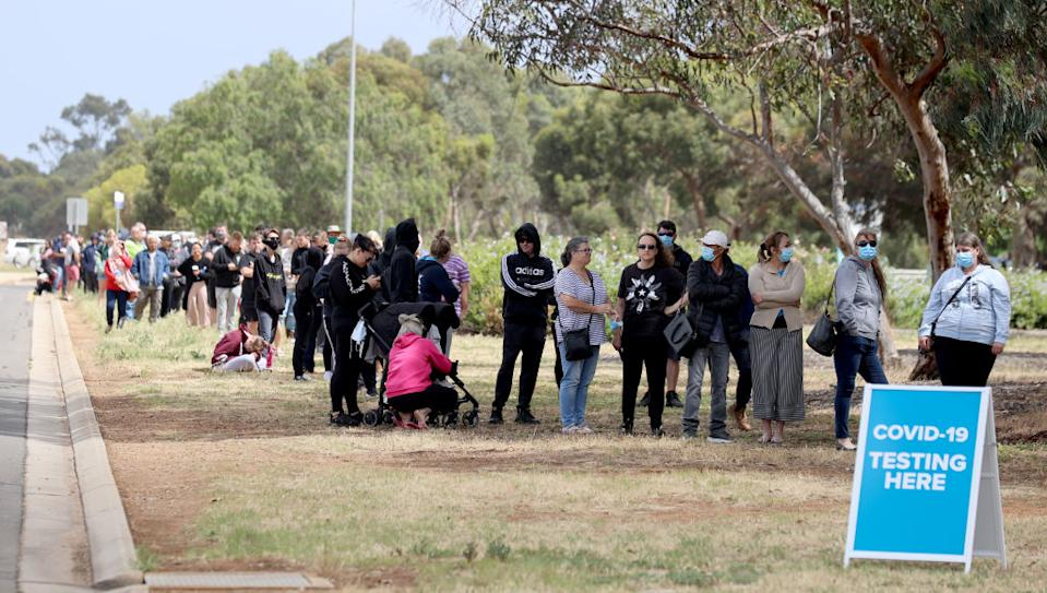 People queuing at the COVID-19 testing site at Parafield Airport in Adelaide on Monday. Source: Getty
