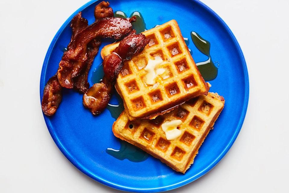 """Bacon on the side of your waffles: a given. Bacon folded into the batter of your cornmeal waffles: next level. <a href=""""https://www.epicurious.com/recipes/food/views/crispy-cornmeal-bacon-waffles-109154?mbid=synd_yahoo_rss"""" rel=""""nofollow noopener"""" target=""""_blank"""" data-ylk=""""slk:See recipe."""" class=""""link rapid-noclick-resp"""">See recipe.</a>"""