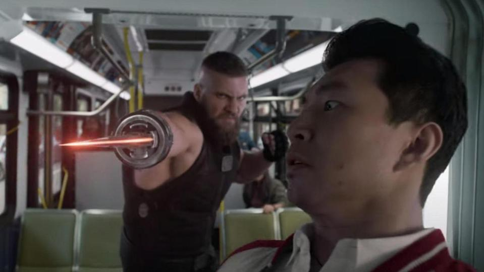 Razor Fist uses his shining red blade to attack Shang-Chi on a bus in San Francisco