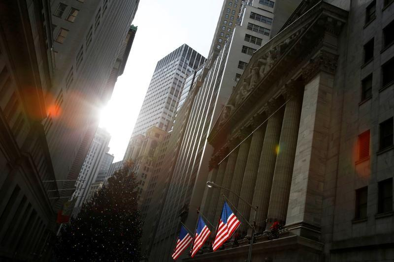 U.S. flags hang at the New York Stock Exchange in New York City