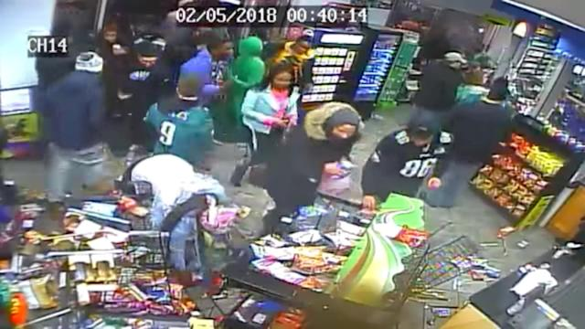 A group of people destroys a convenience store after Super Bowl in Philadelphia, U.S., February 5, 2018 in this still image obtained from PHILADELPHIA POLICE DEPARTMENT /via REUTERS THIS IMAGE HAS BEEN SUPPLIED BY A THIRD PARTY. MANDATORY CREDIT. NO RESALES. NO ARCHIVES
