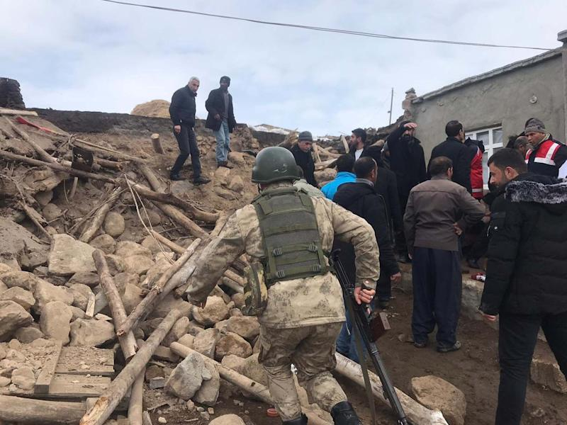 Teams inspect the wreckage of a mud-brick construction after tremors from a 5.7-magnitude quake centered in northwestern Iran were also felt in Turkey's Van province: Anadolu Agency via Getty Images