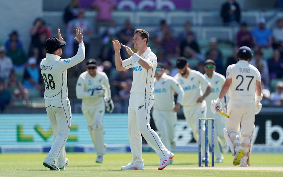 New Zealand celebrate the early wicket of Rory Burns - PA