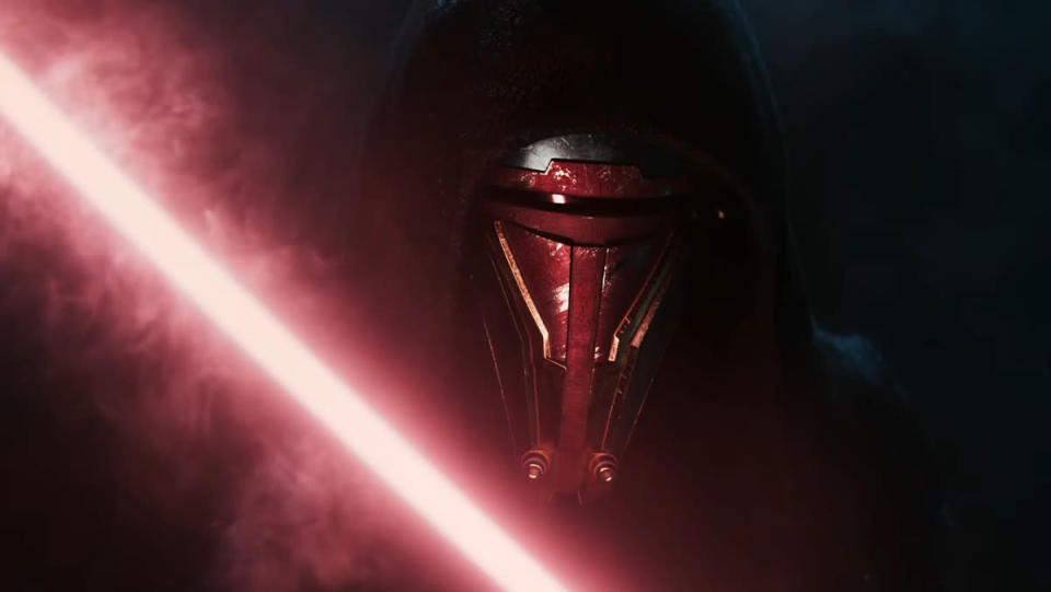 A red lightsaber in front of a masked character in Star Wars: Knights of the Old Republic remake teaser