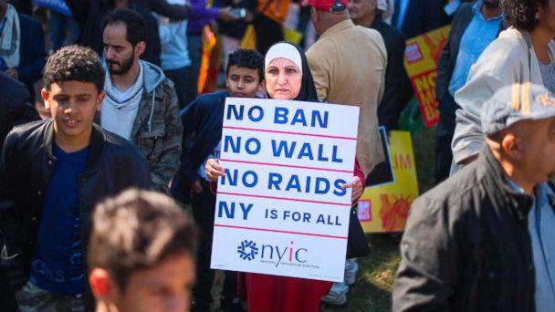 PHOTO: A demonstrator holds up a placard as other pass by during a #NoMuslimBanEver rally and march in Washington, D.C., Oct. 18, 2017. (Jim Watson/AFP/Getty Images)