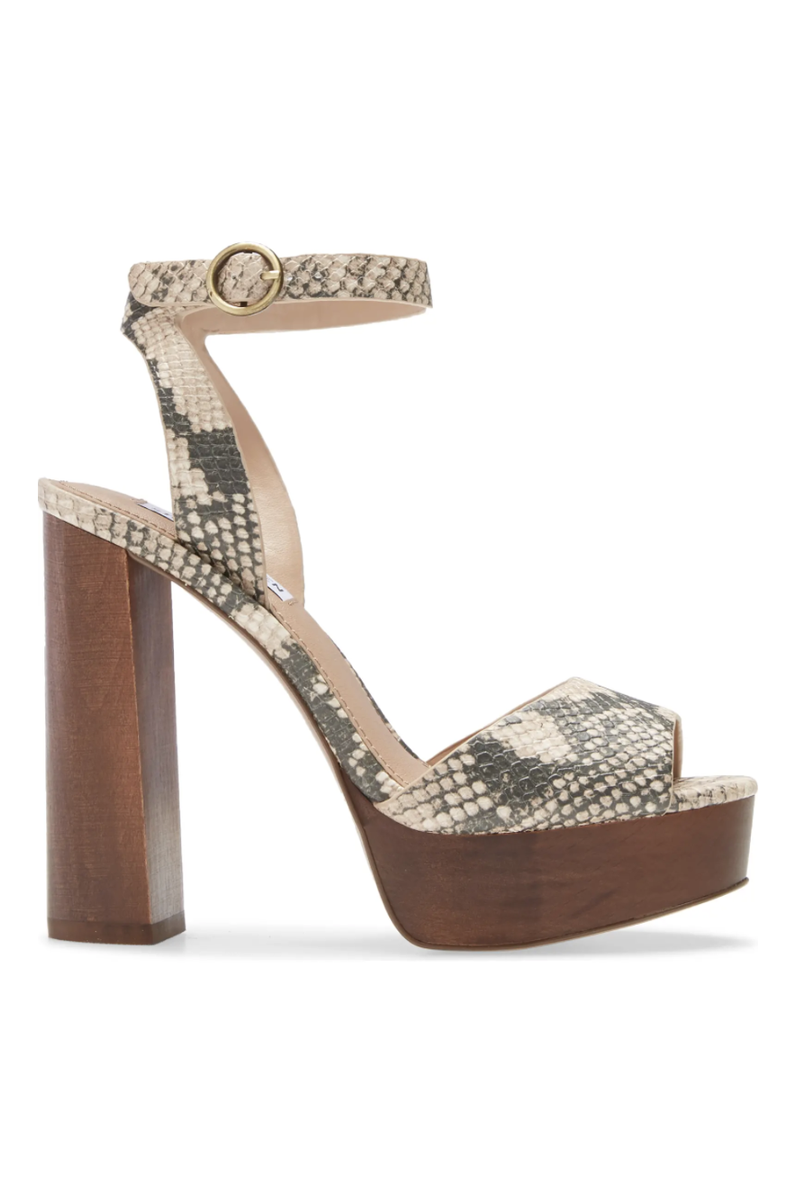 """<p><strong>Steve Madden</strong></p><p>nordstrom.com</p><p><strong>$129.95</strong></p><p><a href=""""https://go.redirectingat.com?id=74968X1596630&url=https%3A%2F%2Fwww.nordstrom.com%2Fs%2Fsteve-madden-mckinley-platform-block-heel-sandal-women%2F5683684&sref=https%3A%2F%2Fwww.marieclaire.com%2Ffashion%2Fg34126792%2Fspring-shoe-trends-2021%2F"""" rel=""""nofollow noopener"""" target=""""_blank"""" data-ylk=""""slk:Shop Now"""" class=""""link rapid-noclick-resp"""">Shop Now</a></p><p>These have a 70's vibe but don't feel too disco-y. You can easily pair with a short suit for day and a puff-sleeved mini for evening.</p>"""