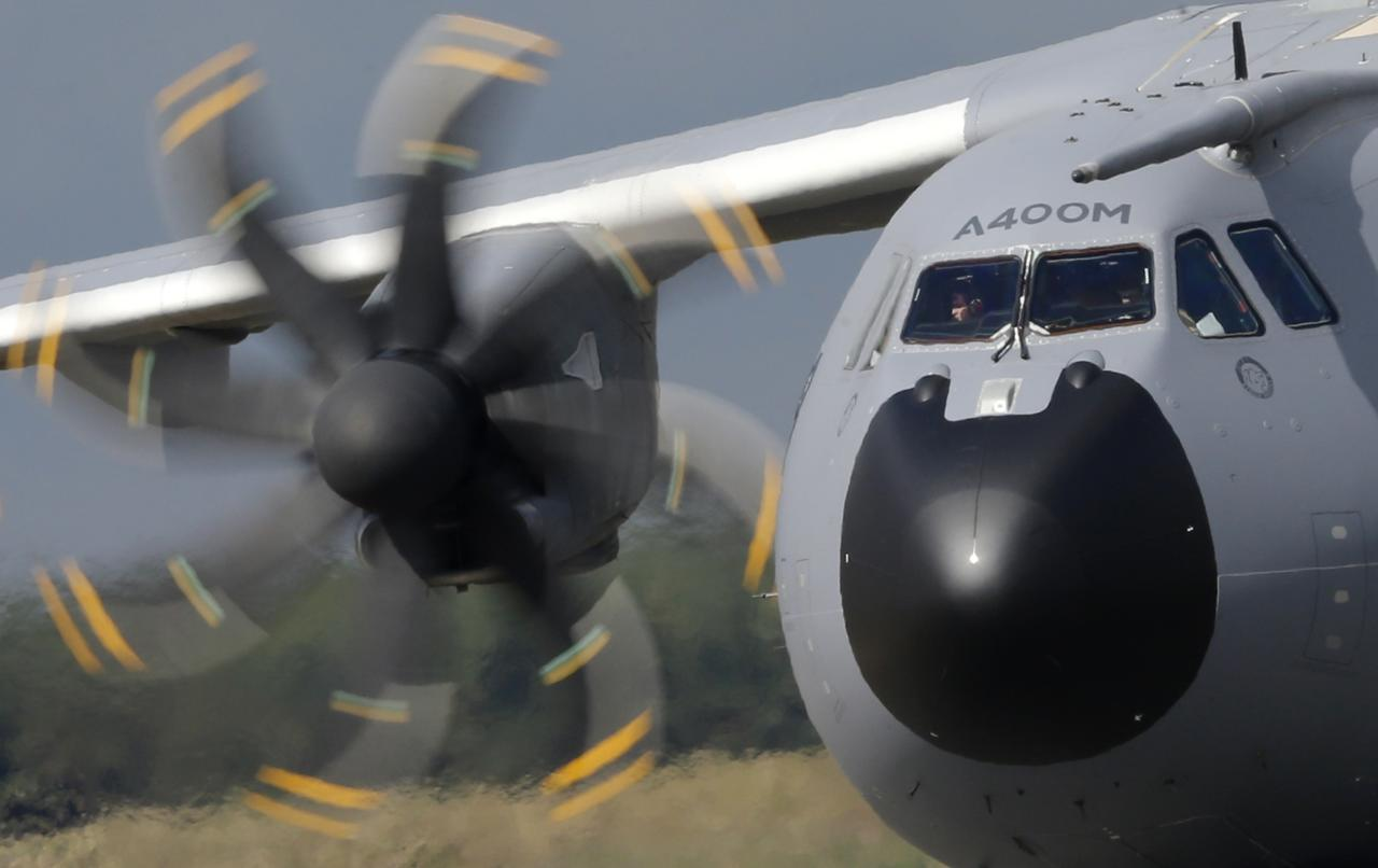 A new Airbus A400M military aircraft rolls on the runway after landing at Orleans air base, September 30, 2013. The troop carrier was conceived in the 1980s to meet a looming shortfall in military transport capacity among seven European NATO nations: Belgium, Britain, France, Germany, Luxembourg, Spain and Turkey. REUTERS/Christian Hartmann (FRANCE - Tags: TRANSPORT MILITARY)