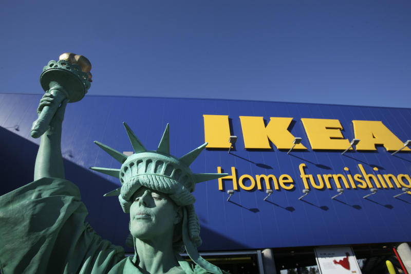 Penny England is the Statue of Liberty during the grand opening of New York City's first Ikea store on Wednesday, June 18, 2008 in the Red Hook section of Brooklyn. The Swedish-based retailer, which sells easy-assembly furniture and house wares, has 34 other stores in the United States. (AP Photo/Mark Lennihan)