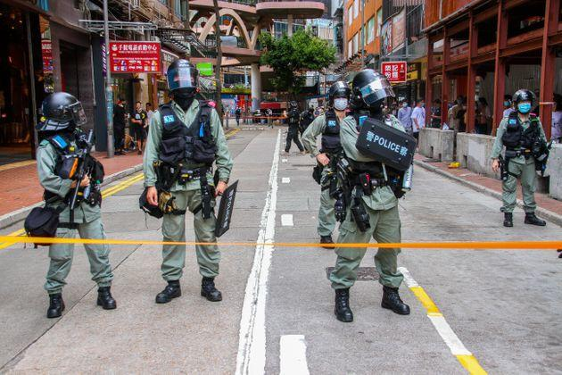 Police stand behind the cordon line during street rallies in Causeway Bay, Hong Kong, China on July 1, 2020. (Photo by Tommy Walker/NurPhoto via Getty Images)