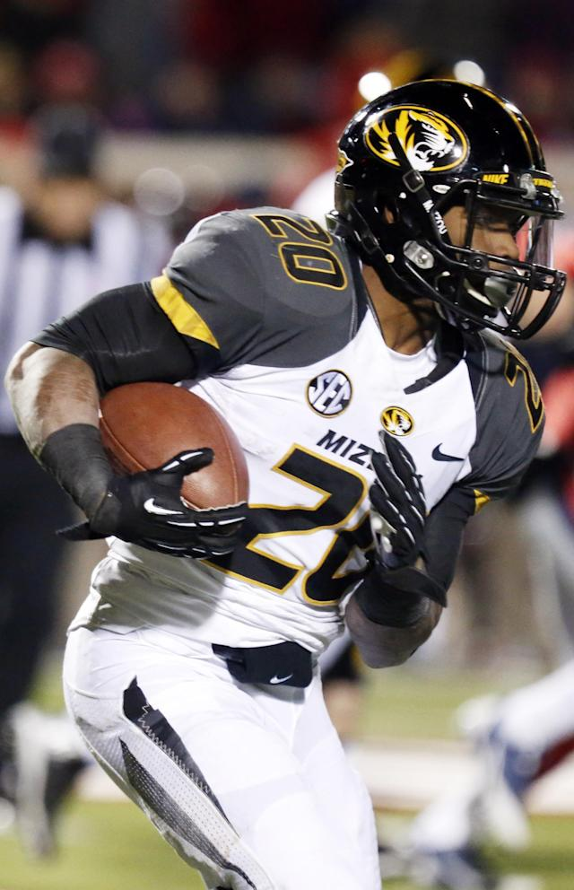 Missouri running back Henry Josey (20) runs through Mississippi defenders for short yards in the second half of a NCAA college football game Saturday, Nov. 23, 2013, in Oxford, Miss. No. 8 Missouri won 24-10. (AP Photo/Rogelio V. Solis)