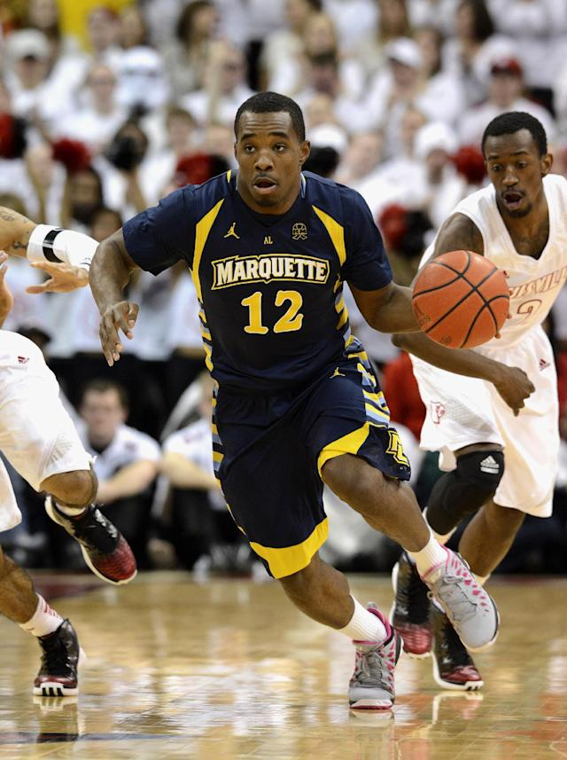 FILE - In this Feb. 3, 2013 file photo, Marquette guard Derrick Wilson brings the ball upcourt during the first half of their NCAA mens college basketball game in Louisville, Ky. No. 17 Marquette's returning strength is in the frontcourt, but backcourt play might determine how far the Golden Eagles go in a season that starts Friday night. New starting point guard Wilson is building trust with coach Buzz Williams. (AP Photo/Timothy D. Easley, File)