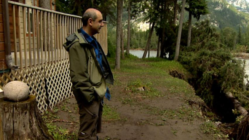 Farshad Sepandj's house at Lac des Arcs is much closer to the water since last month's flooding. A large section of his property was sucked into a sinkhole