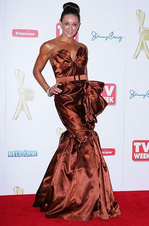 Fitness guru Michelle Bridges may have a killer bod - but this dress just doesn't do her justice. The shiny fabric and the fussy fishtail hem look out of place and Michelle's high bun is a bit too severe. The main issue is the orangey-brown colour, which blends a little too well with her spray tan. Source: Getty