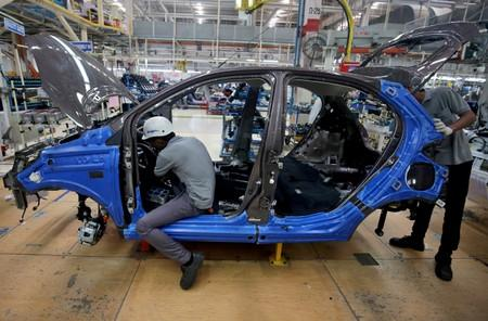 Workers on a car assembly line at the Tata Motors plant in Sanand, on the outskirts of Ahmedabad