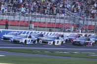 NASCAR Cup Series driver Kyle Larson (5) leads the pack to start the NASCAR Cup Series auto race at Charlotte Motor Speedway in Concord, N.C., Sunday, May 30, 2021. (AP Photo/Nell Redmond)