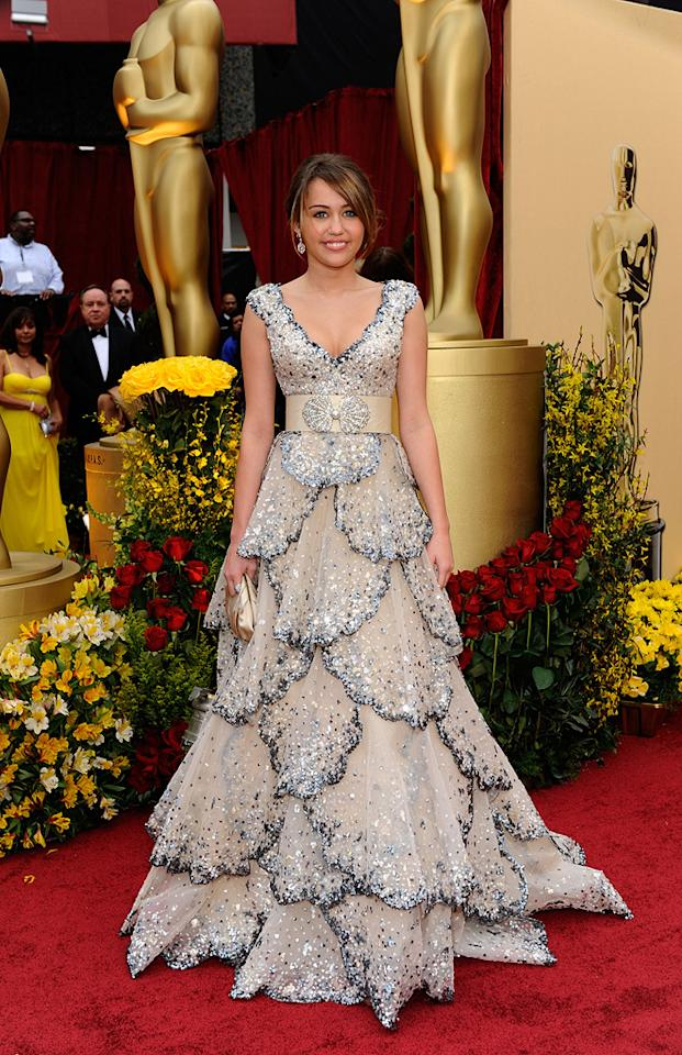 Miley Cyrus   Grade: F       The tween queen failed to impress in an overly layered Zuhair Murad mess of a dress.