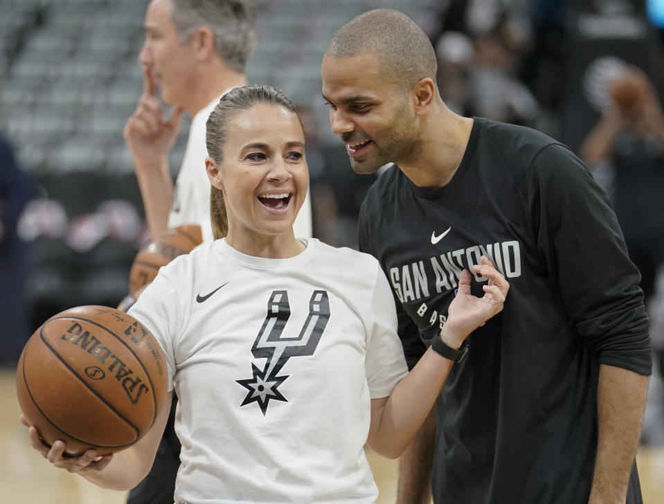 San Antonio Spurs guard Tony Parker, right, laughs with Spurs assistant coach Becky Hammon before an NBA basketball game against the Orlando Magic, Tuesday, March 13, 2018, in San Antonio. San Antonio won 108-72. (AP Photo/Darren Abate)