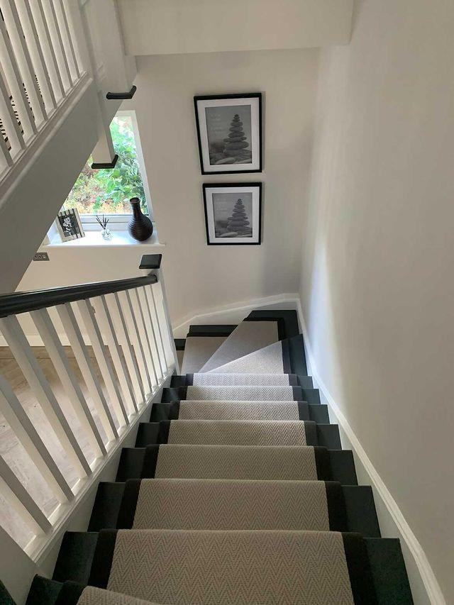 """<p>When choosing stair carpets in a busy home, opt for carpets which are stain-resistant and durable.</p><p>'Herringbone wool carpets for stairs meet the demands of busy households wanting to make eco-conscious choices when it comes to their flooring,' say the experts at <a href=""""https://www.tapi.co.uk/"""" rel=""""nofollow noopener"""" target=""""_blank"""" data-ylk=""""slk:Tapi Carpets"""" class=""""link rapid-noclick-resp"""">Tapi Carpets</a>. 'Wool and woven carpets are extremely cosy and exude elegance but the natural fibres used have elasticity and bounce back making it extra durable.'</p><p>Pictured: <a href=""""https://www.tapi.co.uk/"""" rel=""""nofollow noopener"""" target=""""_blank"""" data-ylk=""""slk:Carpet runner in the style 'Herringbone' by Tapi Carpets"""" class=""""link rapid-noclick-resp"""">Carpet runner in the style 'Herringbone' by Tapi Carpets</a></p>"""