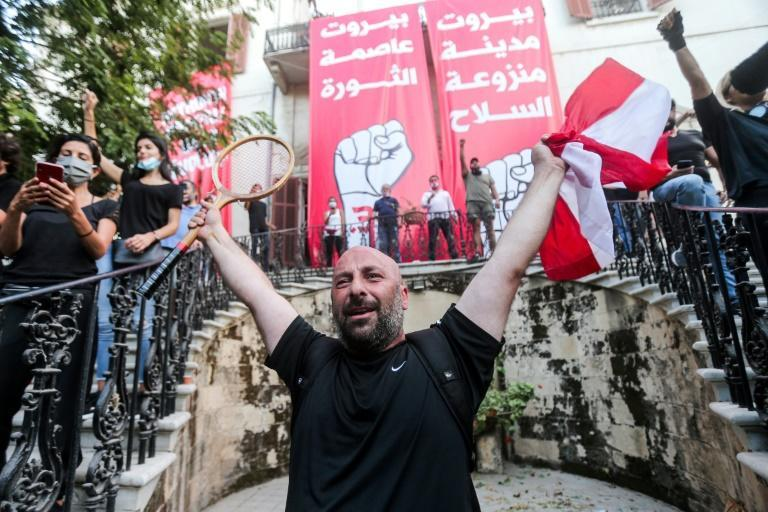 Lebanese protesters celebrate storming the Ministry of Foreign Affairs in Beirut