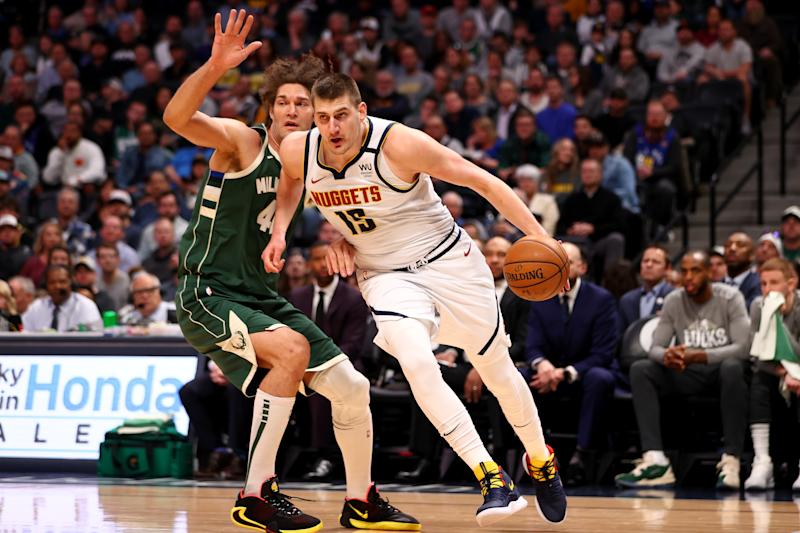 DENVER, CO - MARCH 09: Nikola Jokic #15 of the Denver Nuggets drives past Robin Lopez #42 of the Milwaukee Bucks at Pepsi Center on March 9, 2020 in Denver, Colorado. NOTE TO USER: User expressly acknowledges and agrees that, by downloading and/or using this photograph, user is consenting to the terms and conditions of the Getty Images License Agreement (Photo by Jamie Schwaberow/Getty Images)
