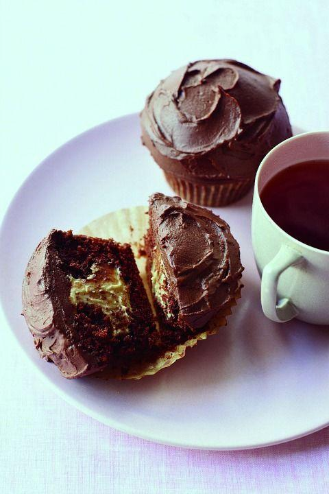 """<p>The ultimate recipe for PB-and-chocolate fans, these moist, chocolatey cupcakes come complete with a sweet peanut butter filling and a silky slathering of chocolate–sour cream frosting.</p><p><strong><a href=""""https://www.womansday.com/food-recipes/food-drinks/recipes/a11126/peanut-butter-chocolate-cupcakes-recipe-122602/"""" rel=""""nofollow noopener"""" target=""""_blank"""" data-ylk=""""slk:Get the recipe."""" class=""""link rapid-noclick-resp"""">Get the recipe.</a></strong></p>"""