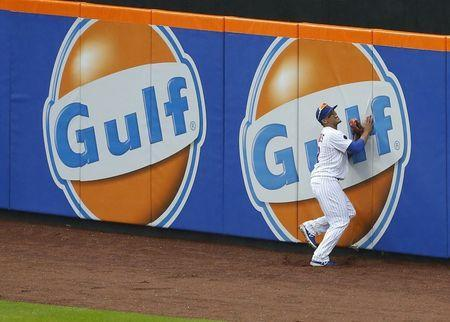May 16, 2018; New York City, NY, USA; New York Mets center fielder Juan Lagares (12) grimaces after catching a ball in the eighth inning against the Toronto Blue Jays at Citi Field. Mandatory Credit: Noah K. Murray-USA TODAY Sports