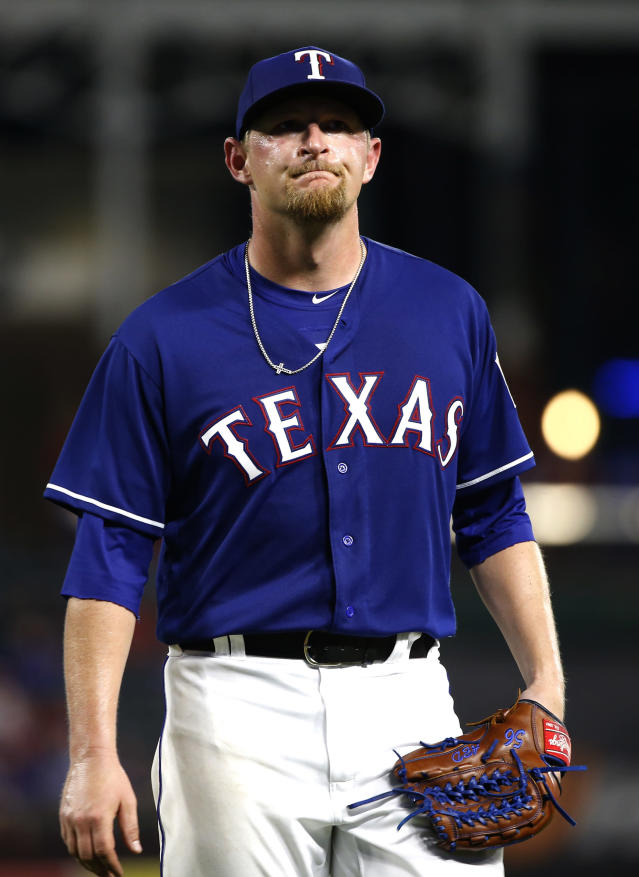 Texas Rangers starting pitcher Austin Bibens-Dirkx leaves the mound during the seventh inning of the team's baseball game against the Kansas City Royals on Thursday, May 24, 2018, in Arlington, Texas. (AP Photo/Ron Jenkins)