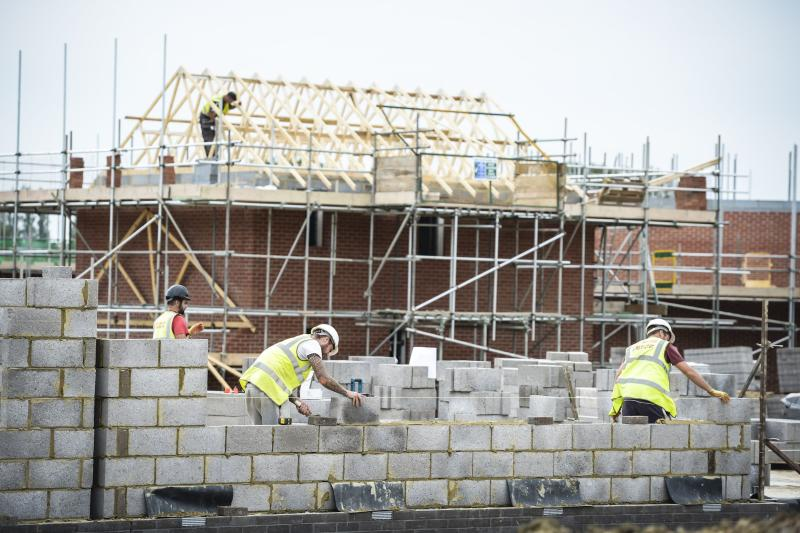 Builders lay blocks on a building site near Bristol, as a new report found that Britain's chronic brick shortage is ramping up house prices and the situation could be made worse by the Brexit vote.