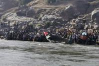 Ethiopians who fled the ongoing fighting in Tigray region prepare to cross the Setit River on the Sudan-Ethiopia border in Hamdait village in eastern Kassala state