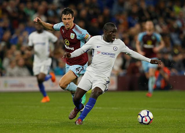 "Soccer Football - Premier League - Burnley vs Chelsea - Turf Moor, Burnley, Britain - April 19, 2018 Chelsea's N'Golo Kante in action with Burnley's Jack Cork REUTERS/Andrew Yates EDITORIAL USE ONLY. No use with unauthorized audio, video, data, fixture lists, club/league logos or ""live"" services. Online in-match use limited to 75 images, no video emulation. No use in betting, games or single club/league/player publications. Please contact your account representative for further details."